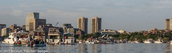 Boats lined up in front of Boston skyline waiting for the fireworks (Red anchorage zone)