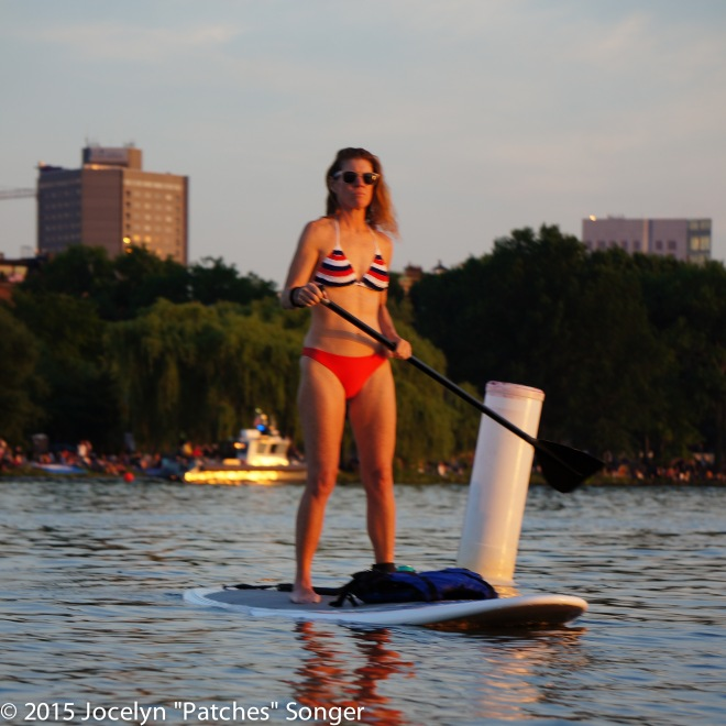 4th of July paddle-boarder in front of boundary buoy for the safety zone.