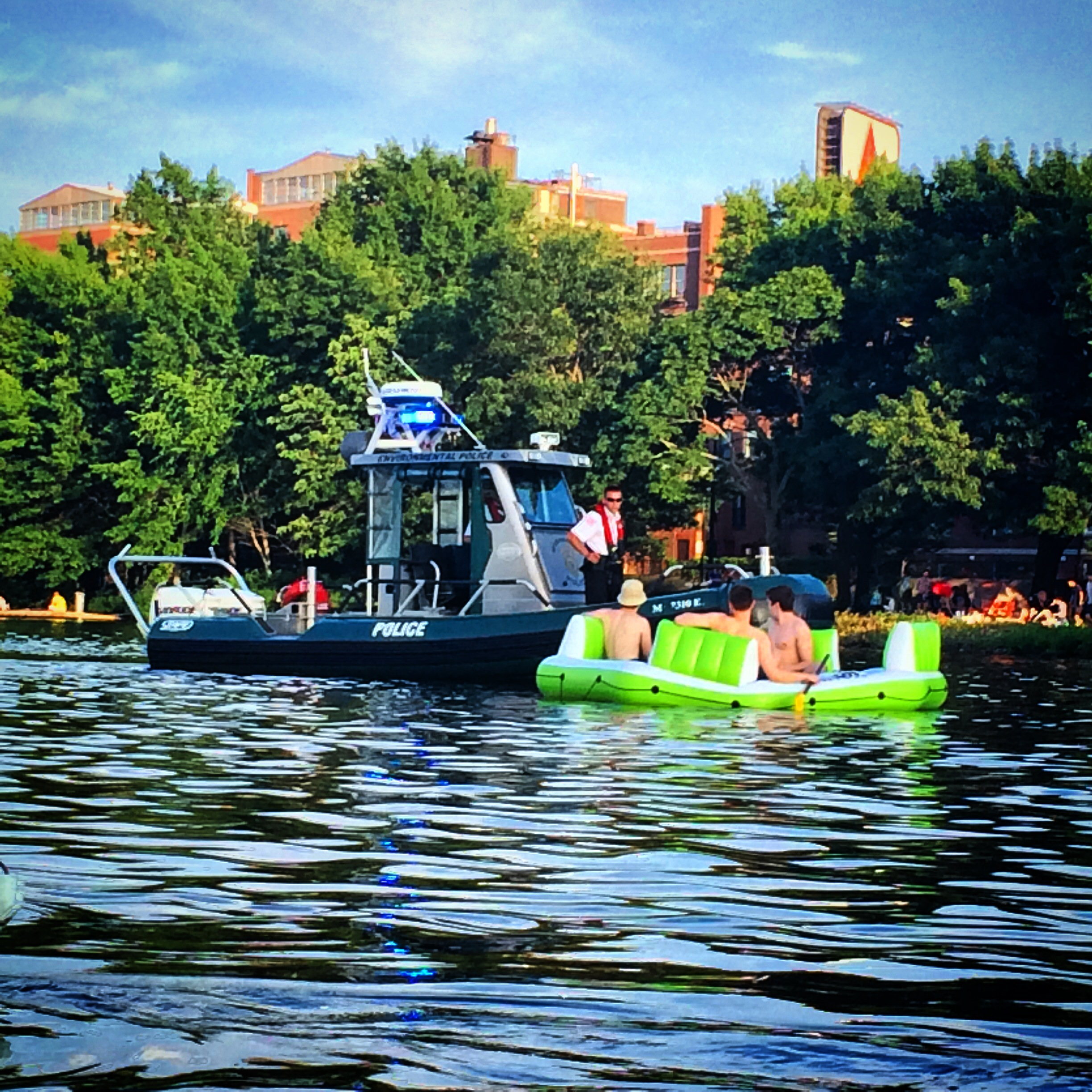 State police marine unit enforcing life jacket rules.