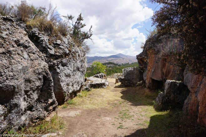 Looking through the rocks of the X-Zone to the hills of Cusco beyond