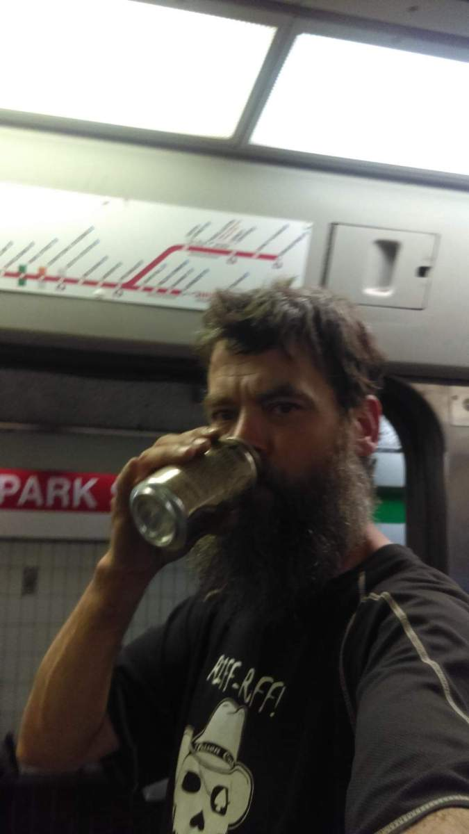 City Slicka Patrick O'Meara drinking on a red line train in Boston