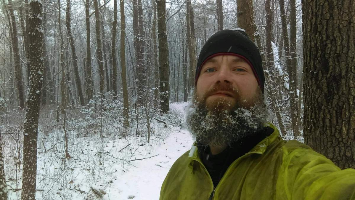 City Slicka Patrick O'Meara backpacking with a beard full of ice